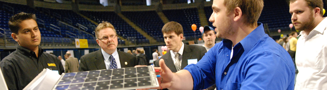 college engineering students show their projects to event attendees