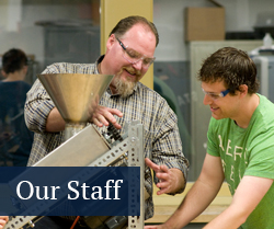 student working with Learning Factory shop manager on a piece of equipment